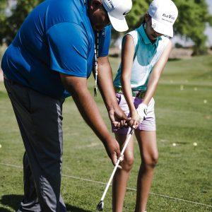 woman-holding-golf-club-near-man-1325652